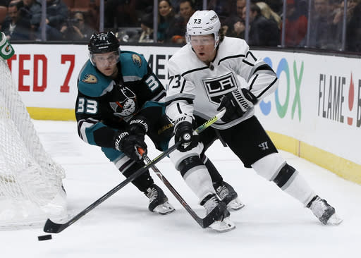 Los Angeles Kings right wing Tyler Toffoli, right, controls the puck with Anaheim Ducks right wing Jakob Silfverberg, left, of Sweden, trailing during the second period of an NHL hockey game in Anaheim, Calif., Sunday, March 10, 2019. (AP Photo/Alex Gallardo)