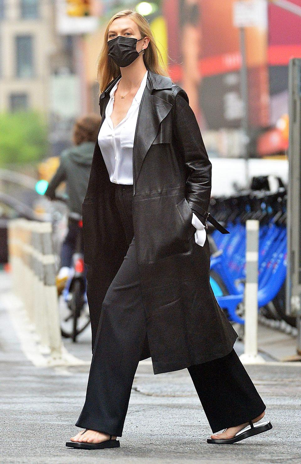 <p>Karlie Kloss looks ready for the boardroom in her black-and-white ensemble in N.Y.C. on Thursday.</p>