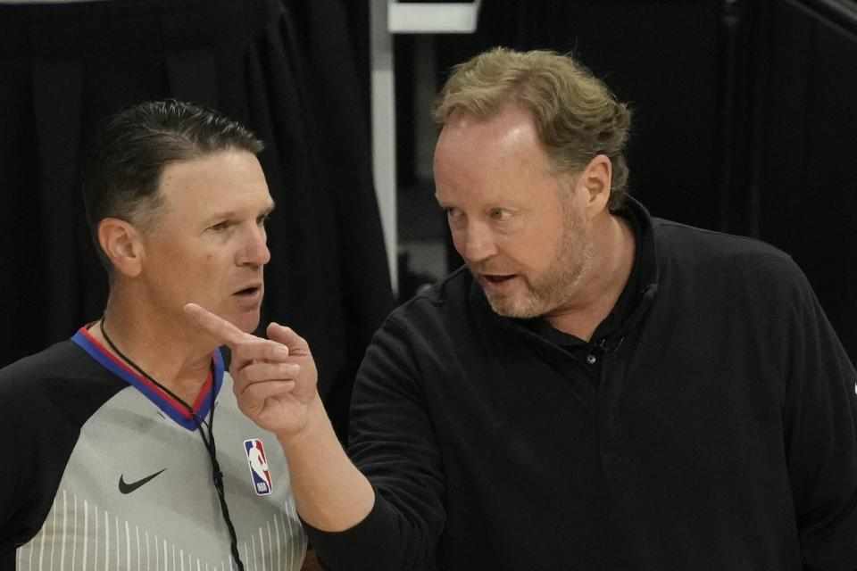Milwaukee Bucks head coach Mike Budenholzer argues a call during the first half of Game 2 of the NBA Eastern Conference basketball finals game against the Atlanta Hawks Friday, June 25, 2021, in Milwaukee. (AP Photo/Morry Gash)