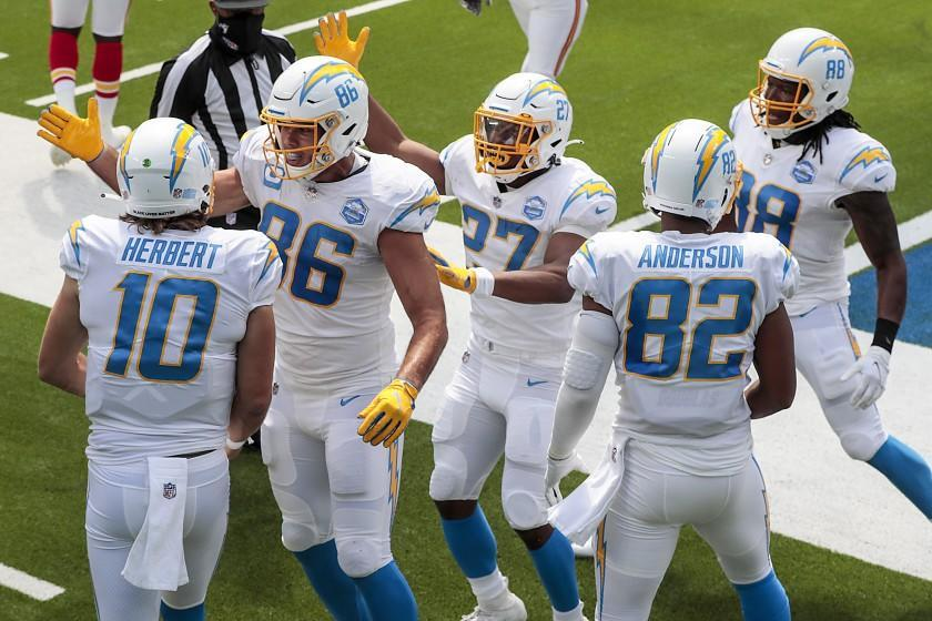 Inglewood, CA, Sunday, September 20, 2020 - Quarterback Justin Herbert #10 of the Los Angeles Chargers celebrates with teammates after scoring his first career touchdown on a first quarter scramble against the Kansas City Chiefs at SoFi Stadium. (Robert Gauthier/ Los Angeles Times)