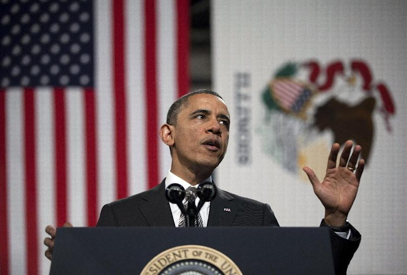 President Barack Obama gestures as he speaks at Hyde Park Academy on Friday, Feb. 15, 2013, in Chicago. Obama is traveling to promote the economic and educational plan he laid out in his State of the Union address. (AP Photo/Evan Vucci)