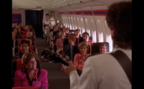 <p>Note to self: If you're ever trying to win someone back, serenading them over the loud speaker of a plane will do the trick. At least, that's what Robbie Hart (Adam Sandler) did to win Julia Sullivan (Drew Barrymore) back.</p>