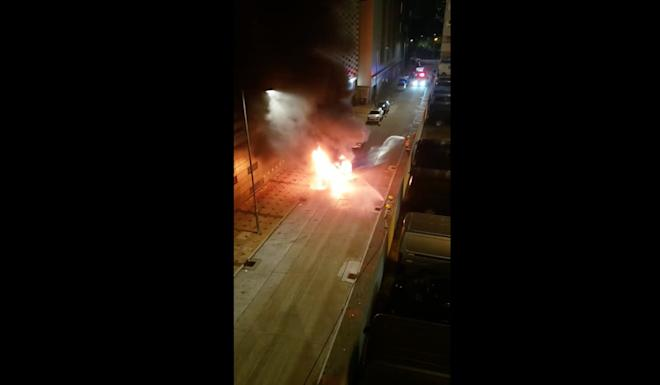 A seven-seater car burst into flames outside a factory building in Wang Mau Street, Kowloon Bay. Photo: Facebook