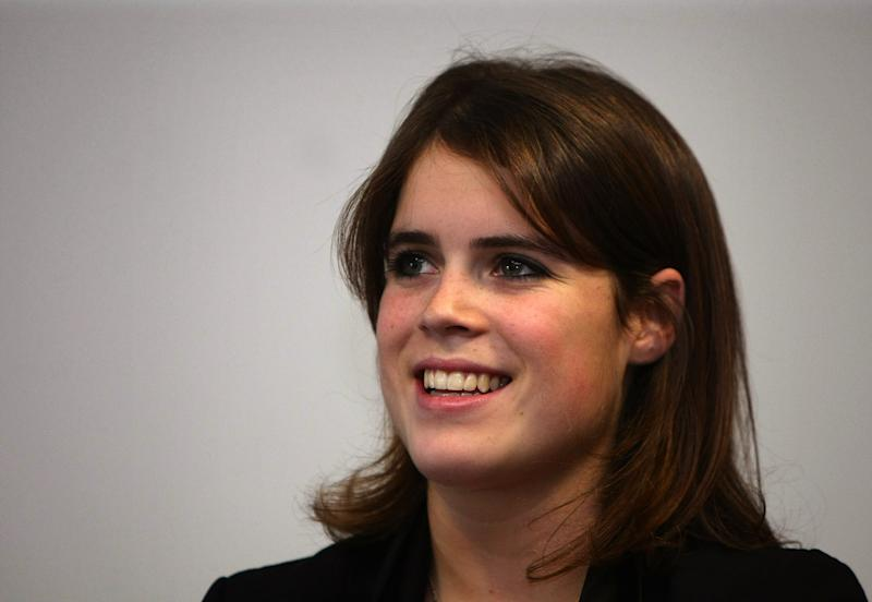 LEEDS, UNITED KINGDOM - OCTOBER 23: Princess Eugenie listens to her mother Sarah Ferguson, Duchess of York give a speech during a visit to the new Teenage Cancer Unit at St James' Hospital on October 23, 2008 in Leeds, England. The Duchess has been Patron of The Teenage Cancer Trust since its inception 15 years ago. During the visit she introduced her daughter Eugenie to the work of the Trust enabling her to see first hand how important these units are. The nine bed centre is the Teenage Cancer Trust's ninth unit in the UK and cost the charity GBP1.25 million. (Photo by Christopher Furlong/Getty Images)
