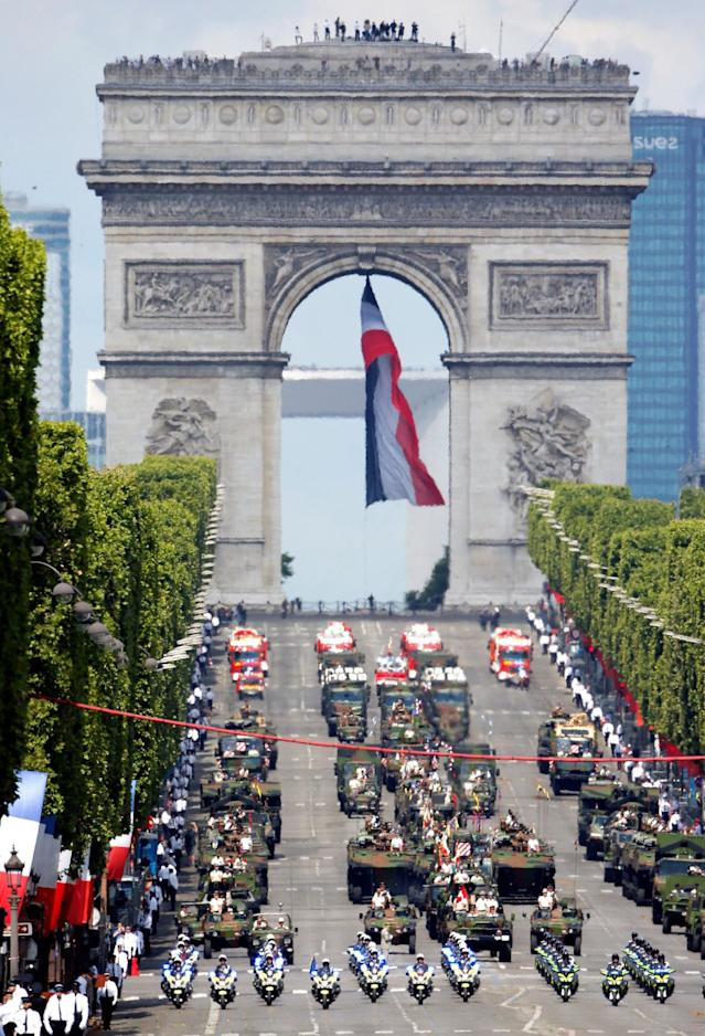 <p>Tanks roll down the Champs-Elysee avenue with the Arc de Triomphe in the background during the traditional Bastille Day military parade in Paris, France, July 14, 2017. (Photo: Gonzalo Fuentes/Reuters) </p>