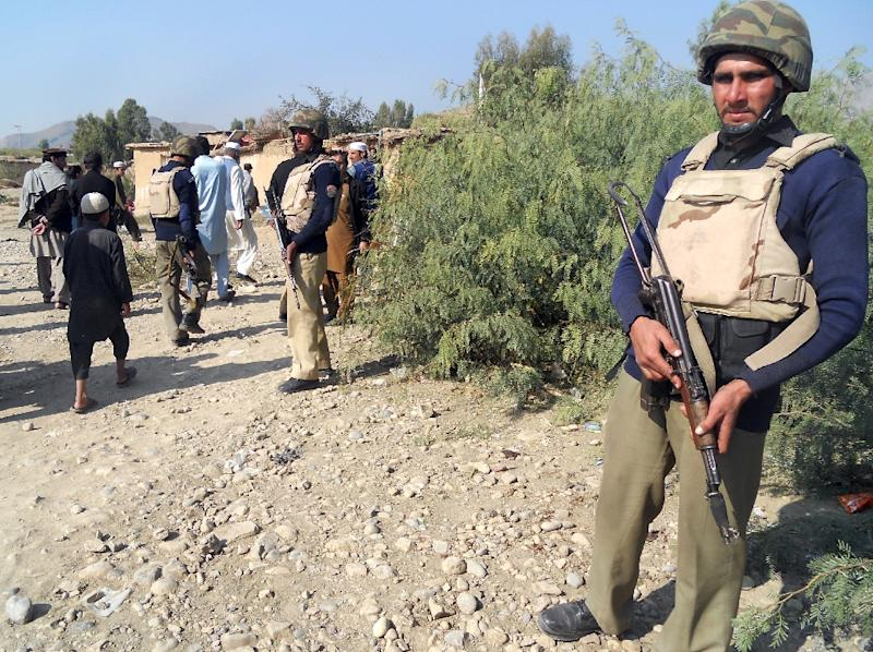 Pakistani policemen stand guard near a destroyed Islamic seminary belonging to the Haqqani network after a US drone strike in the Hangu district of Khyber Pakhtunkhwa province on November 21, 2013