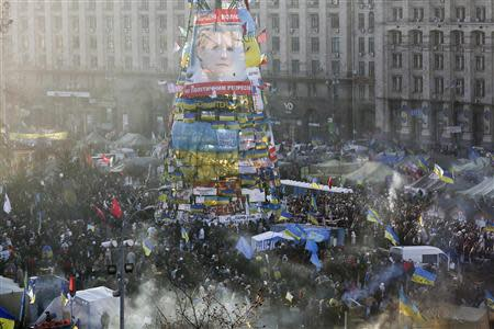 Pro-European integration protesters gather under an image of imprisoned former Prime Minister Yulia Tymoshenko during a rally in Independence square in Kiev December 22, 2013. REUTERS/Maxim Zmeyev