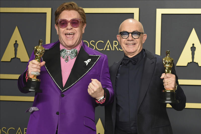 "Elton John, left, and Bernie Taupin, winners of the award for best original song for ""(I'm Gonna) Love Me Again"" from ""Rocketman"", pose in the press room at the Oscars on Sunday, Feb. 9, 2020, at the Dolby Theatre in Los Angeles. (Photo by Jordan Strauss/Invision/AP)"