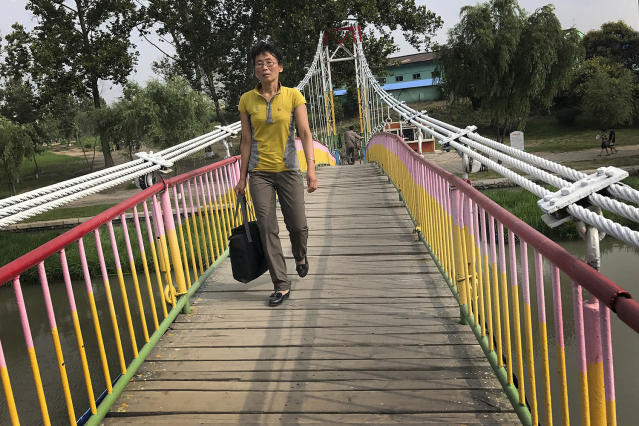 <p>A North Korean crosses the Pothong River via a suspended bridge at the start of a work day on July 19, 2017, in Pyongyang, North Korea. (Photo: Wong Maye-E/AP) </p>