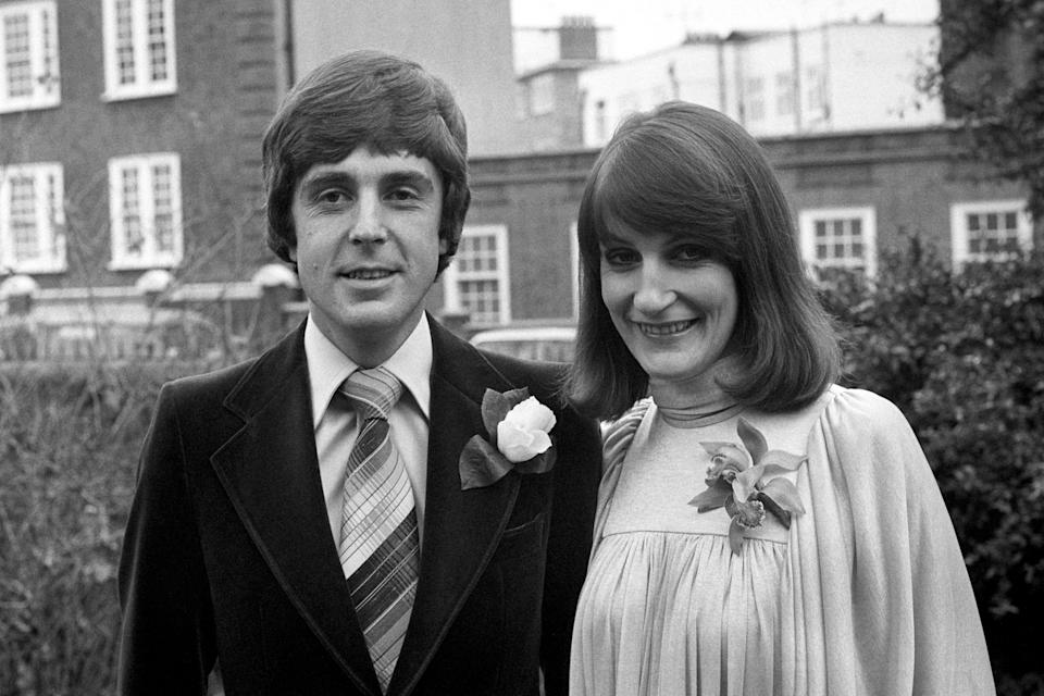"""John Stapleton, one of the presenters of the BBC's """"Nationwide"""" programme with his bride, 29 year old journalist Lynn Faulds Wood, after their wedding at Richmond Register Office.   (Photo by PA Images via Getty Images)"""