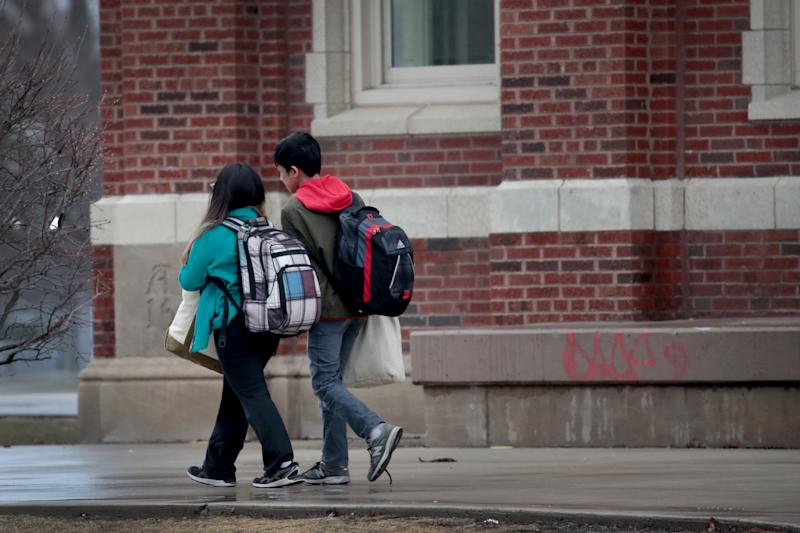 CHICAGO, ILLINOIS - MARCH 16: Students leave Lane Tech College Prep High School at the end of the school day on March 16, 2020 in Chicago, Illinois. Schools in the city have been ordered to close beginning tomorrow for at least the next two weeks in an attempt to stop the spread of COVID-19. (Photo by Scott Olson/Getty Images)