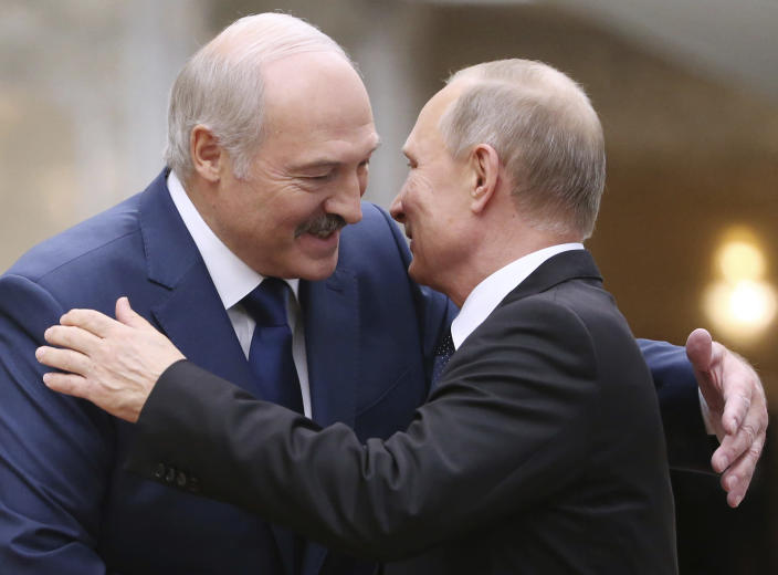 FILE In this file photo taken on Thursday, Nov. 30, 2017, Belarusian President Alexander Lukashenko, left, greets Russian President Vladimir Putin during the Collective Security Council of the Collective Security Treaty Organization (CSTO) summit in Minsk, Belarus. Belarus' authoritarian President Alexander Lukashenko faces a perfect storm as he seeks a sixth term in the election held Sunday, Aug. 9, 2020 after 26 years in office. Mounting public discontent over the worsening economy and his government's bungled handling of the coronavirus pandemic has fueled the largest opposition rallies since the Soviet collapse. (Tatyana Zenkovich, Pool Photo via AP, File)