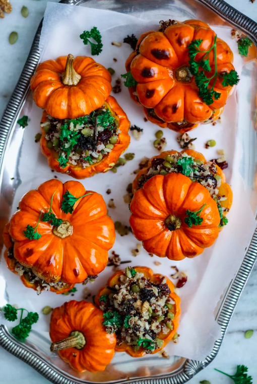 "<a href=""https://www.twospoons.ca/single-post/2017/10/31/Stuffed-Mini-Pumpkins-with-Wild-Rice-and-Kale"" rel=""nofollow noopener"" target=""_blank"" data-ylk=""slk:Stuffed Mini Pumpkins with Wild Rice and Kale"" class=""link rapid-noclick-resp"">Stuffed Mini Pumpkins with Wild Rice and Kale</a> by Two Spoons. (Photo: Two Spoons)"