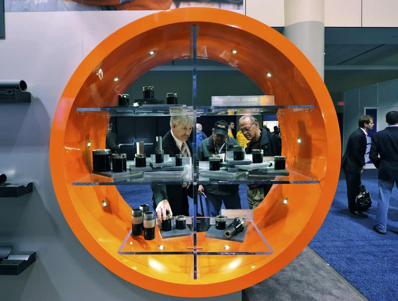 File photo of delegates looking at drill bits during the PDAC trade show in Toronto