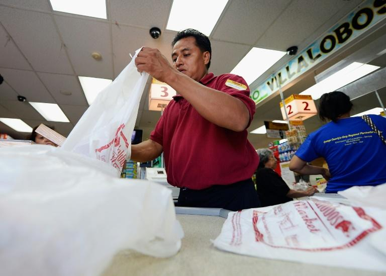 The growing global crisis of plastics waste is often framed as a problem stemming from careless consumers, but a new bill introduced in the US Congress seeks to shift the responsiblity back to industry (AFP Photo/KEVORK DJANSEZIAN)