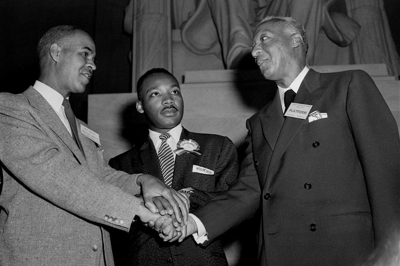 <p>Pictured left to right at the Freedom Pilgrimage rally at the Lincoln Memorial, Washington, D.C., May 17, 1957, are: Roy Wilkins of New York, executive secretary of the NAACP; the Rev. Martin Luther King, Jr. of Montgomery, Ala.; and A. Philip Randolph of New York, president of the Brotherhood of Sleeping Car Porters. (AP Photo/Charles Gorry) </p>