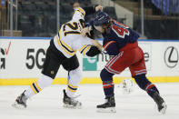Brendan Lemieux, right, of the New York Rangers, fights Nick Ritchie, left, of the Boston Bruins during the third period of an NHL game at Madison Square Garden Sunday, Feb. 28, 2021, in New York. (Sarah Stier/Pool Photo via AP)
