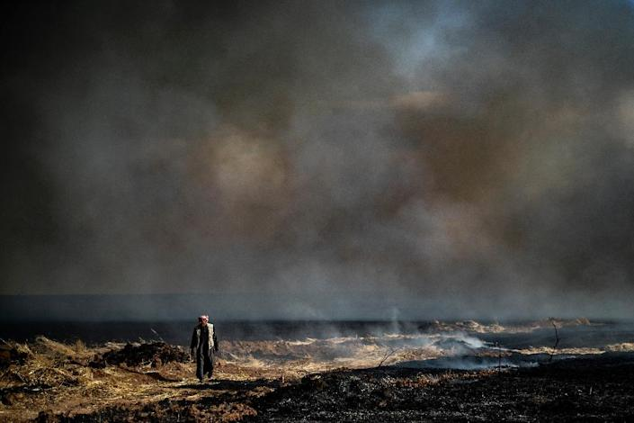 The Islamic State group has claimed several arson attacks on wheat fields in Syria, including in the Kurdish-run breadbasket province of Hasakeh (AFP Photo/Delil souleiman)
