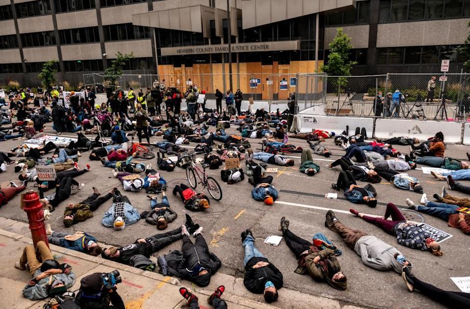 Demonstrators stage a die in outside the Hennepin county family justice center on 11 September 2020 in Minneapolis, Minnesota.