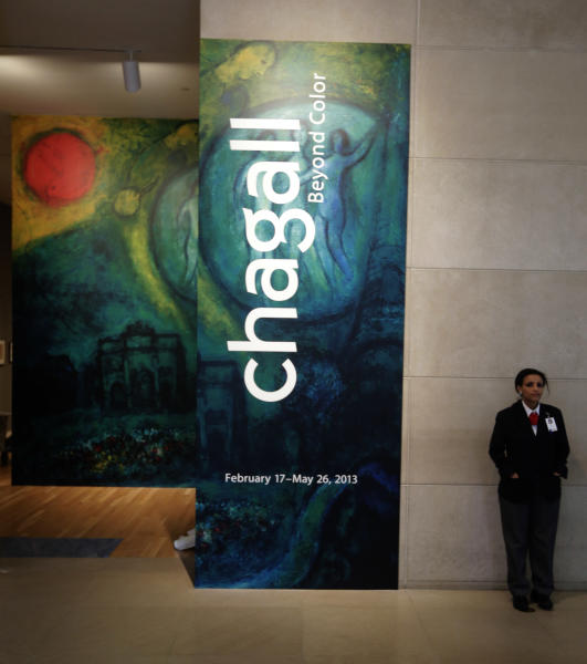"""In this photo taken Wednesday, Feb. 13, 2013, a guard stands at the entrance of the """"Chagall: Beyond Color,"""" exhibit during a preview at the Dallas Museum of Art in Dallas. This will be the only U.S. venue to host the exhibit that opens to the public on Sunday. (AP Photo/LM Otero)"""