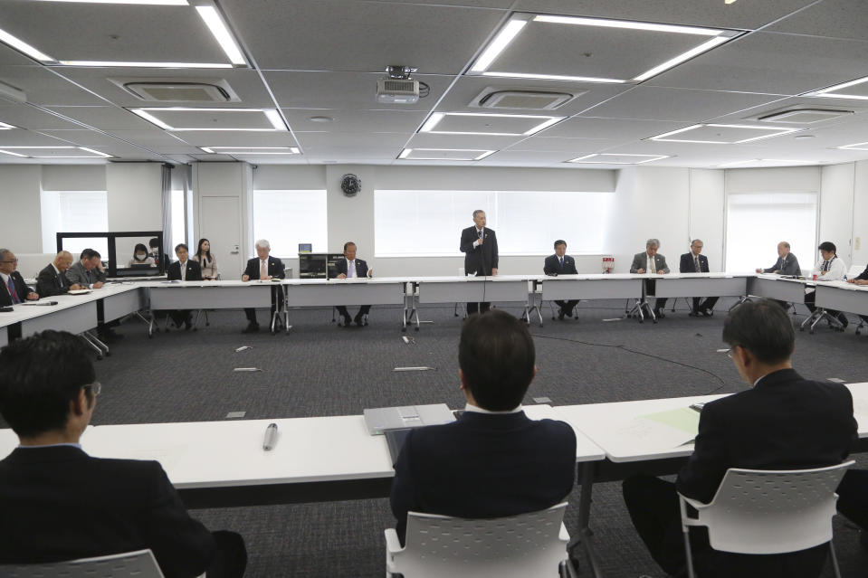 """Tokyo 2020 Organizing Committee President Yoshiro Mori, center at rear, speaks during the first meeting of the """"Tokyo 2020 New Launch Task Force"""" in Tokyo, Thursday, March 26, 2020, two days after the unprecedented postponement was announced due to the spreading coronavirus. The new Tokyo Olympics need dates for the opening and closing ceremony in 2021. Nothing moves until this is worked out by the International Olympic Committee, the Japanese government, and Tokyo organizers.(AP Photo/Koji Sasahara)"""
