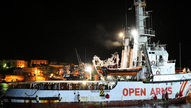 Migrants on 'Open Arms' humanitarian ship arrive on Lampedusa