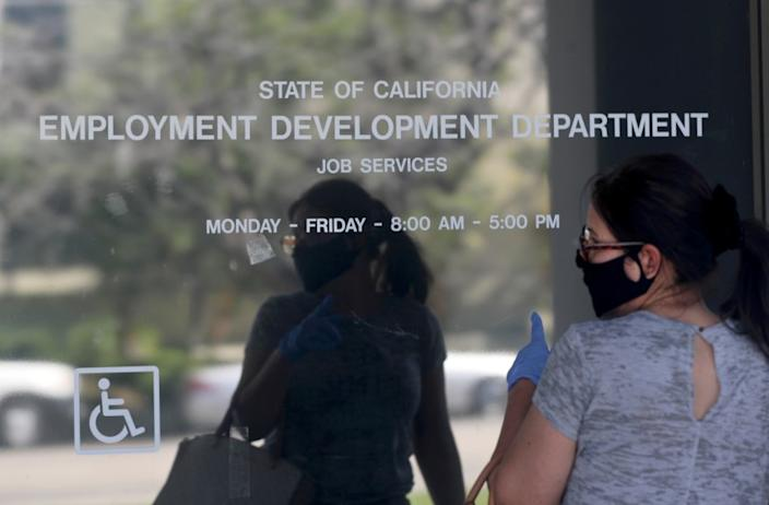 CANOGA PARK, CA - MAY 14: Maria Mora came to find information about her claim but found the California State Employment Development Department was closed due to coronavirus concerns on Thursday, May 14, 2020 in Canoga Park, CA. (Brian van der Brug / Los Angeles Times)