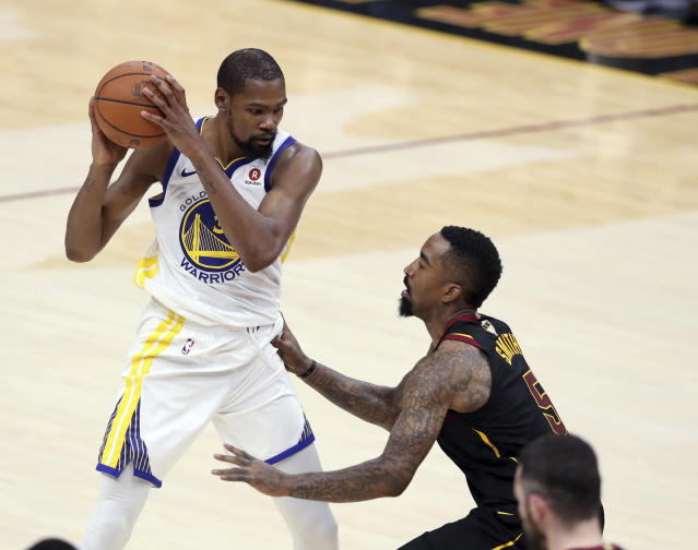<p> Golden State Warriors' Kevin Durant is defended by Cleveland Cavaliers' JR Smith during the second half of Game 4 of basketball's NBA Finals, Friday, June 8, 2018, in Cleveland. (AP Photo/Carlos Osorio) </p>