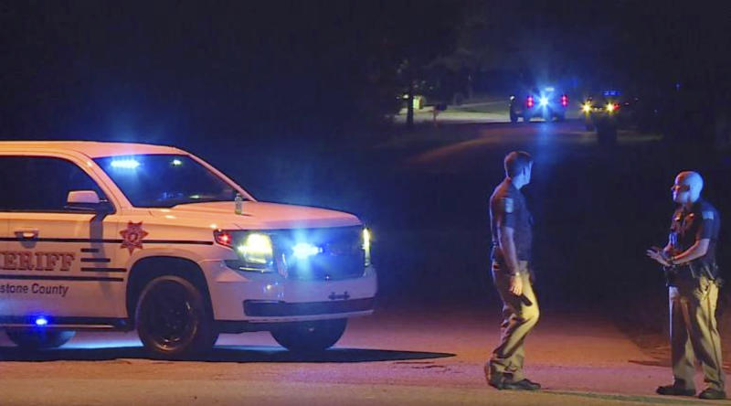 In this photo, police are seen blocking access to a street in Elkmont, Alabama, following the shooting deaths of five family members.