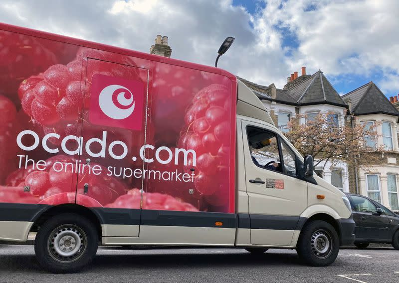 FILE PHOTO: An Ocado delivery van is driven along a road in Hackney, London