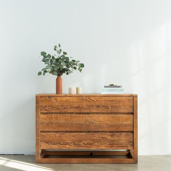 """New Jersey–based Avocado may have made a name for itself with all-natural <a href=""""https://www.architecturaldigest.com/story/best-mattress-in-a-box?mbid=synd_yahoo_rss"""" rel=""""nofollow noopener"""" target=""""_blank"""" data-ylk=""""slk:mattresses"""" class=""""link rapid-noclick-resp"""">mattresses</a>, but its recently unveiled sustainable and eco-friendly minimalist furniture collections are giving the company's bread and butter a run for its money. Case in point: The midcentury modern–inspired Eco Wood dresser, which is handmade in the brand's Los Angeles woodshop with 100% reclaimed wood and finished in a zero-VOC sealant. With simple and clean lines (and no hardware), the organic materials can really shine. $2310, Avocado Green Mattress. <a href=""""https://www.avocadogreenmattress.com/collections/furniture/products/eco-wood-dresser"""" rel=""""nofollow noopener"""" target=""""_blank"""" data-ylk=""""slk:Get it now!"""" class=""""link rapid-noclick-resp"""">Get it now!</a>"""