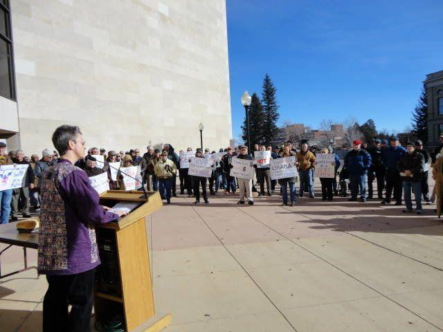 Rev. Dee Lundberg speaks at a rally to protectchildren's access to education