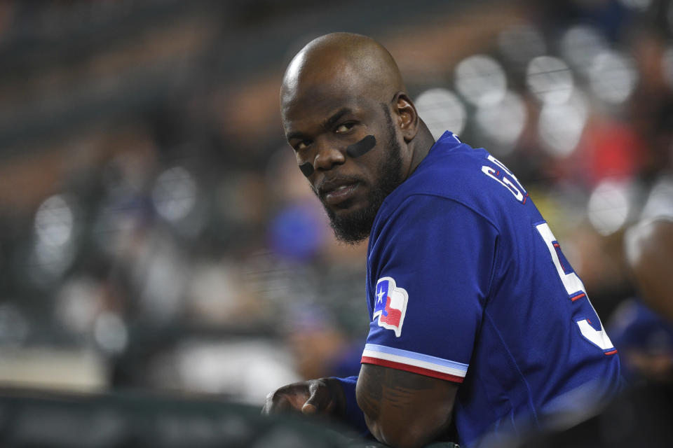 Texas Rangers' Adolis Garcia looks on from the dugout during the second inning of a baseball game against the Baltimore Orioles, Thursday, Sept. 23, 2021, in Baltimore. (AP Photo/Terrance Williams)