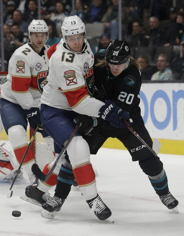 San Jose Sharks left wing Marcus Sorensen (20) reaches for the puck against Florida Panthers defenseman Mark Pysyk (13) during the first period of an NHL hockey game in San Jose, Calif., Thursday, March 14, 2019. (AP Photo/Jeff Chiu)