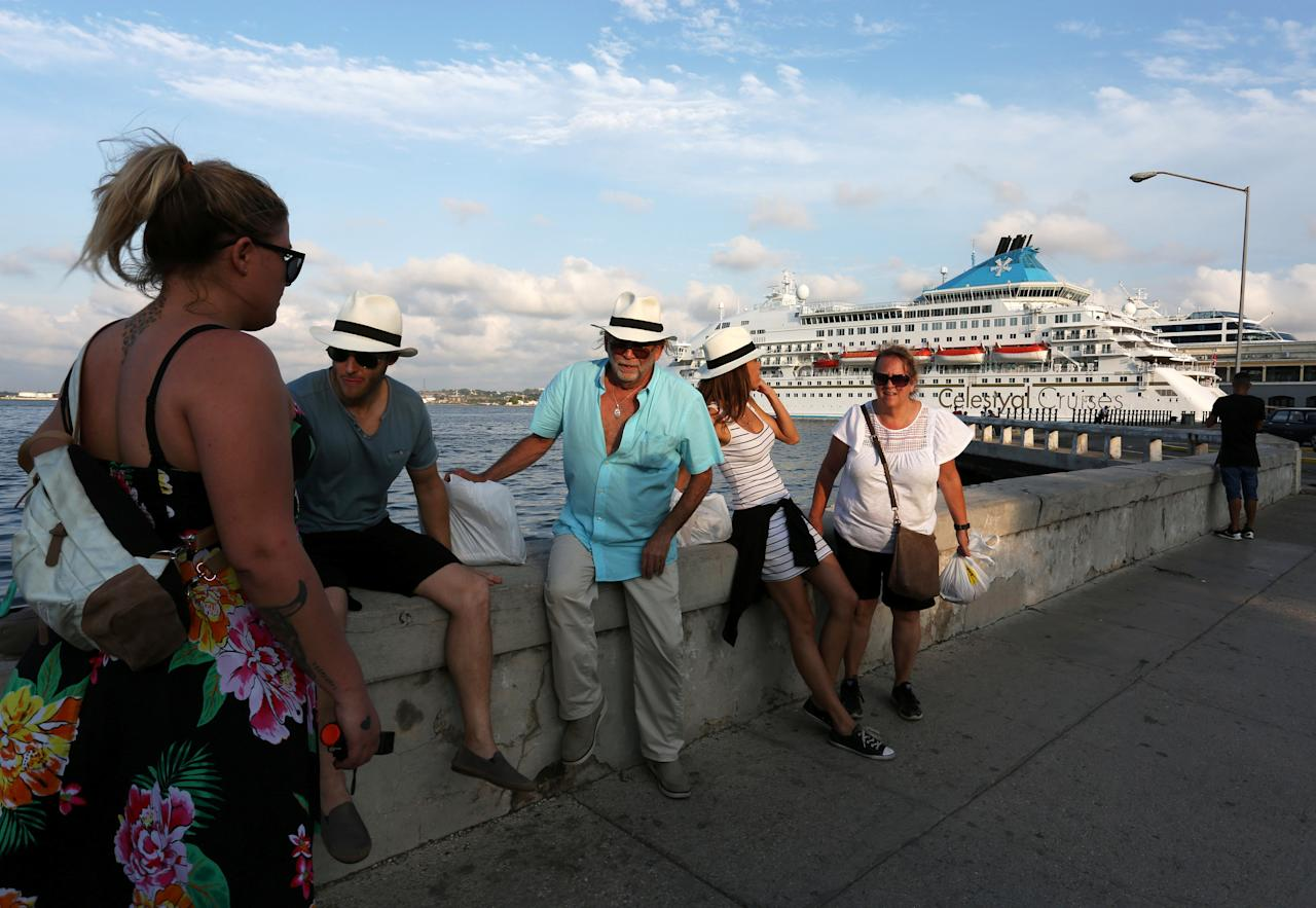Tourists sit near a cruise ship in Havana, Cuba May 15, 2017. Picture taken May 15, 2017. REUTERS/Stringer
