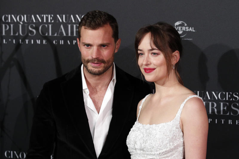 "FILE - In a Tuesday, Feb. 6, 2018 file photo, Jamie Dornan, left, and Dakota Johnson pose during a photocall for the world premiere of 'Fifty Shades Freed - 50 Nuances Plus Claires' at Salle Pleyel in Paris. ""Fifty Shades Freed"" has topped the North American box office in its first weekend in theaters. Universal Pictures estimates Sunday, Feb. 11, 2018 that the final chapter in the Christian Grey and Anastasia Steele saga has earned $38.8 million, which is down significantly from the first film's $85.2 million debut and the sequel's $46.6 million opening.(AP Photo/Francois Mori, File)"