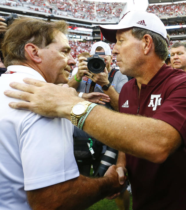 Alabama head coach Nick Saban shakes hands with Texas A&M head coach Jimbo Fisher after the end of an NCAA college football game, Saturday, Sept. 22, 2018, in Tuscaloosa, Ala. (AP Photo/Butch Dill)