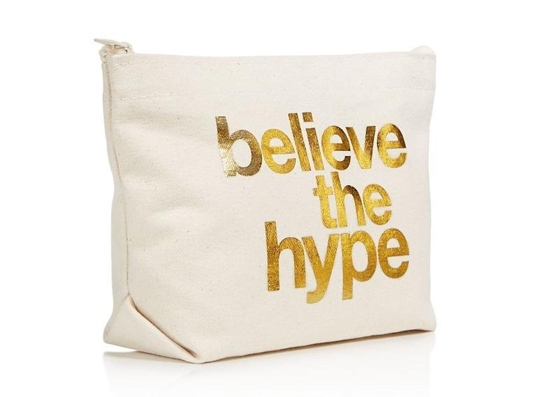"""<i>Buy it from <a href=""""https://www.bloomingdales.com/shop/product/dogeared-believe-the-hype-cosmetics-case-100-exclusive?ID=2724265&CategoryID=16958#fn=ppp%3Dundefined%26sp%3D1%26rId%3D82%26spc%3D45%26cm_kws%3Dmakeup%20bag%26spp%3D15%26pn%3D1%7C1%7C15%7C45%26rsid%3Dundefined"""" target=""""_blank"""">Bloomingdale's</a>for $28.</i>"""