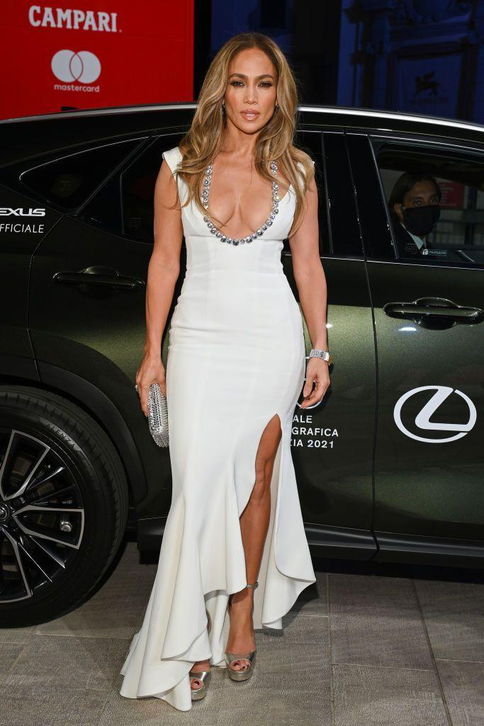 """<p>The arrival that nobody could stop talking about...<a href=""""https://www.elle.com/uk/life-and-culture/a36391980/jennifer-lopez-ben-affleck/"""" rel=""""nofollow noopener"""" target=""""_blank"""" data-ylk=""""slk:to make her (second) red carpet debut with partner Ben Affleck"""" class=""""link rapid-noclick-resp""""> to make her (second) red carpet debut with partner Ben Affleck</a>, Lopez wore a white column gown by Georges Hobeika paired with Cartier jewellery.</p>"""