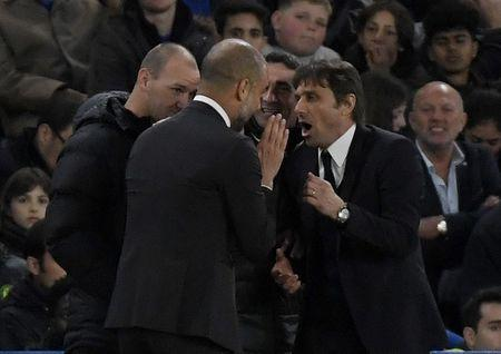 Britain Soccer Football - Chelsea v Manchester City - Premier League - Stamford Bridge - 5/4/17 Manchester City manager Pep Guardiola speaks with Chelsea manager Antonio Conte Reuters / Toby Melville Livepic