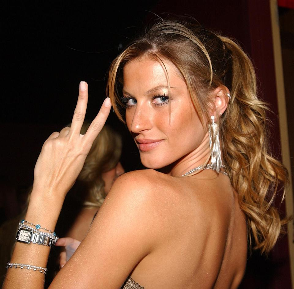 <p>More than a decade ago, Gisele flashed a peace sign at the Palms Hotel and Casino Resort's third anniversary party. (Photo: Getty Images) </p>