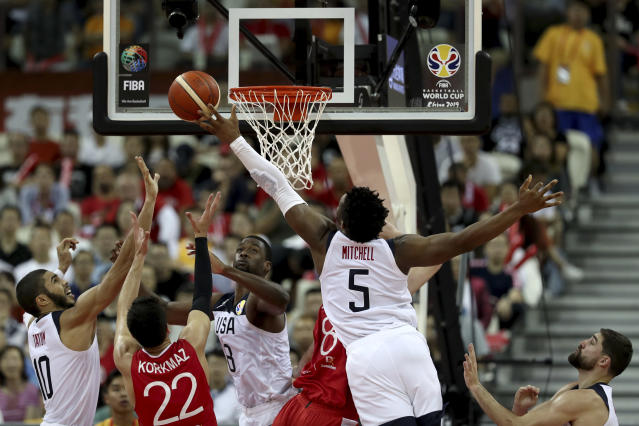 United States' Donovan Mitchell reach for the ball during a Group E match against Turkey for the FIBA Basketball World Cup at the Shanghai Oriental Sports Center in Shanghai on Tuesday, Sept. 3, 2019. The United States beat Turkey 93:92.(AP Photo/Ng Han Guan)