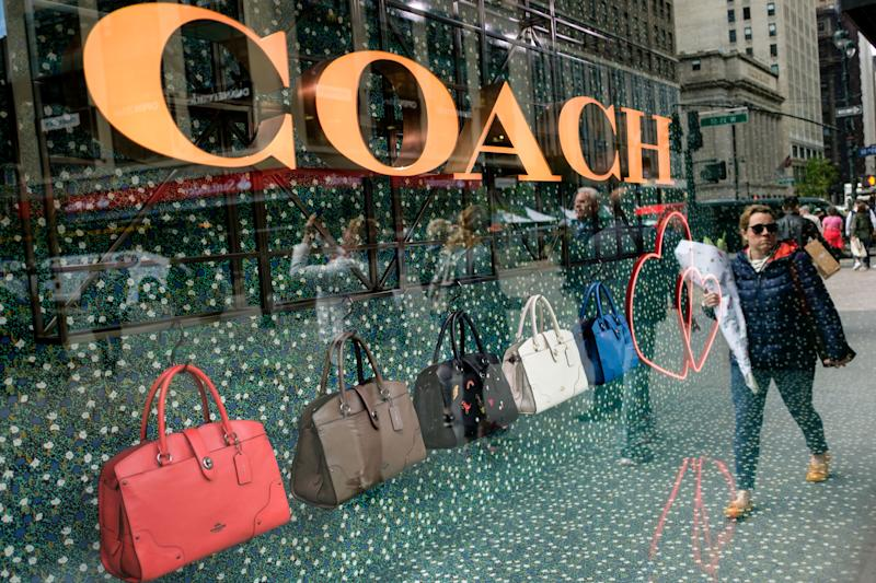 NEW YORK, NY - MAY 12: A woman walks past Coach bags in a window of Macy's flagship store, May 12, 2017 in the Herald Square neighborhood in New York City. The U.S. Commerce Department says retail sales rose 0.4 percent in April from March. (Photo by Drew Angerer/Getty Images)