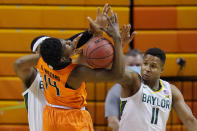 Baylor forward Flo Thamba, left, and guard Mark Vital (11) knock the ball away from Oklahoma State guard Bryce Williams (14) in the first half of an NCAA college basketball game, Saturday, Jan. 23, 2021, in Stillwater, Okla. (AP Photo/Sue Ogrocki)