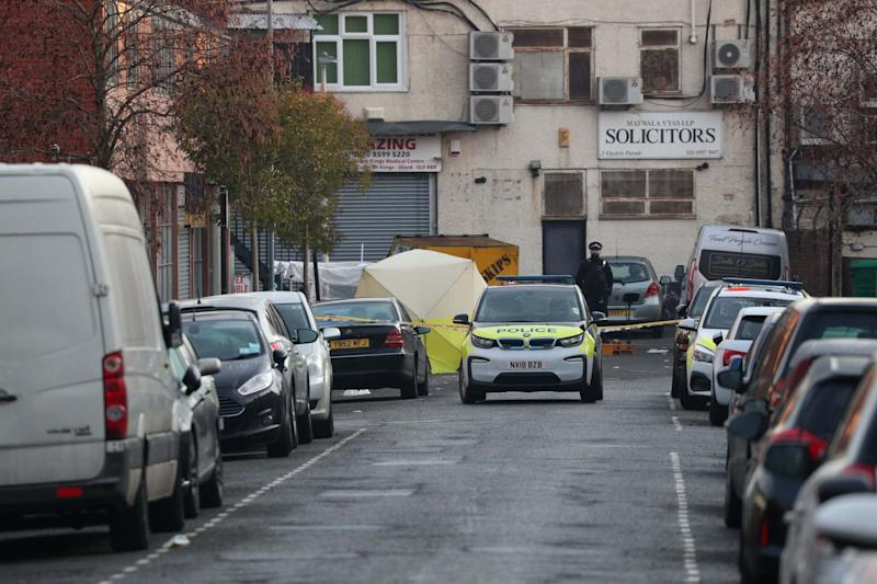 An evidence tent at the scene where three men were found dead (PA)