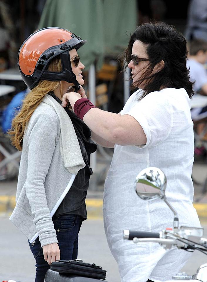 With just one helmet between them, Ms. O'Donnell did the chivalrous thing and made sure her better half's head was protected. Rosie wasn't breaking the law by not wearing a helmet, since the state of Florida doesn't require motorcyclists wear one, but it still sounds kind of dangerous to us! (11/25/2011)