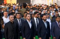 """Hussein Muanis, the leader of a political movement called """"Harakat Huqooq, Arabic for Rights Movement, center left, attends an election rally before the upcoming parliamentary elections in Baghdad, Iraq, Friday, Sept. 3, 2021. Muanis is the leader of Kataeb Hezbollah, one of the most hard-line and powerful militias with close ties to Iran, who once battled U.S. troops. He is the first to be openly affiliated with Kataeb Hezbollah or Hezbollah Brigades, signaling the militant group's formal entry into politics. (AP Photo/Hadi Mizban)"""