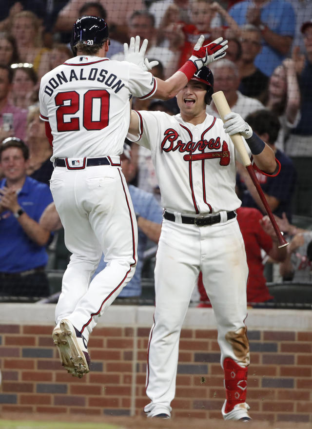 Atlanta Braves' Josh Donaldson (20) celebrates with Austin Riley after hitting a two-run home run in the sixth inning of a baseball game against the New York Mets, Wednesday, June 19, 2019, in Atlanta. (AP Photo/John Bazemore)