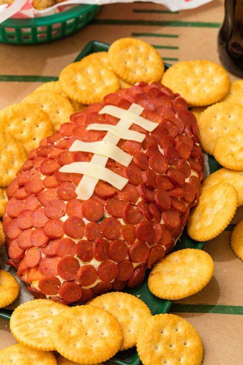 """<p>No catch here. Just a LOT of cheese and crackers. </p><p><a href=""""http://www.delish.com/cooking/recipe-ideas/recipes/a49406/pepperoni-football-recipe/"""" rel=""""nofollow noopener"""" target=""""_blank"""" data-ylk=""""slk:Get the recipe from Delish »"""" class=""""link rapid-noclick-resp""""><em>Get the recipe from Delish »</em></a> </p>"""
