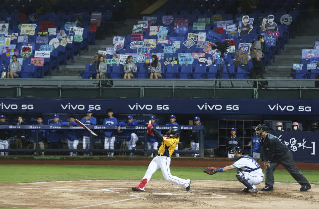 Players of Chinese Professional Baseball League play baseball with no audience at Xinzhuang Baseball Stadium in New Taipei City, Taiwan, Friday, April 24, 2020. Taiwan's five-team Chinese Professional Baseball League is barring spectators over concerns they would spread the deadly coronavirus, meaning games are played with plastic seats void of fans. (AP Photo/Chiang Ying-ying)